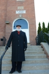Rev. William Grow (portrayed by Mike Gillett) in front of the Baptist Church he built on Mill Street.